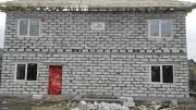 фото ззаду будинку. вікна Rehau без ламінації